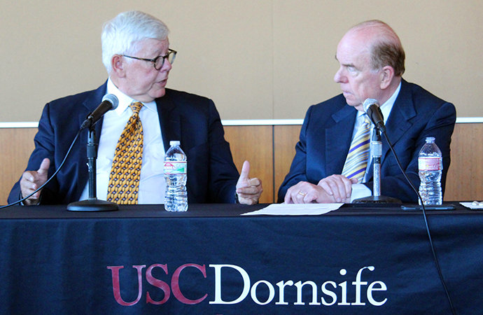 David Keene (left) makes a point while answering a question from Robert Shrum at a USC Dornsife Political Conversations event. Photo by Kristy Plaza.