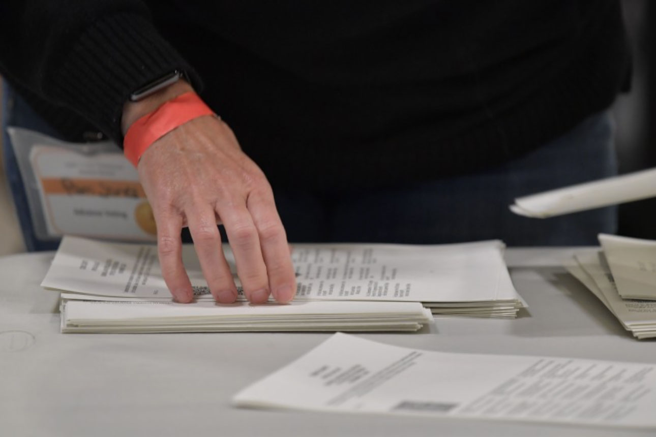 Cobb County election officials handle ballots during an audit on Monday in Marietta, Georgia. (Source: Mike Stewart/Associated Press)