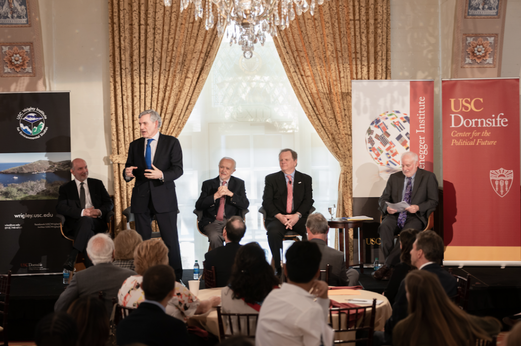 Politics and policy · Former British Prime Minister Gordon Brown (standing) spoke to the audience about the challenges of the 2016 Paris Agreement and the way governments can cooperate to combat climate change. (Ling Luo/Daily Trojan)